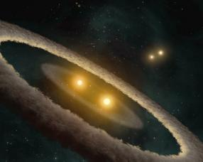 Artist's concepts such as this one are based on infrared spectrometer data from NASA's Spitzer Space Telescope. This rendering depicts a quadru-ple-star system called HD 98800. The system is approximately 10 million years old and is located 150 light-years away in the constellation Crater. Credit: NASA/JPL-Caltech/T. Pyle (SSC)