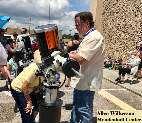 Allen showing the public the solar eclipse